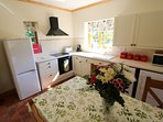 Well equipped kitchen with washer, dishwasher and drier, tall fridge freezer
