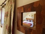 Little touches at character to this master bedroom.