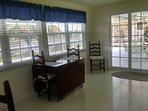 Sun room can be used as a dining room, reading room or water viewing in air conditioned comfort