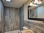 There are rustic elements throughout the bathroom.