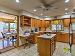 The fully equipped kitchen is perfect for preparing a feast.