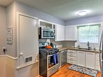 The fully equipped kitchen has ample counter space and granite countertops.