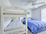With a full bed and twin-over-twin bunk bed, this room sleeps 4.