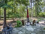 A charcoal grill, chiminea and plenty of seating furnish the patio.