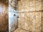 Rinse off the day in the tile lined shower.