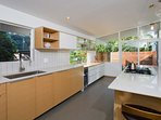 Clean lines and organic wood accents define the high-end cooking space.