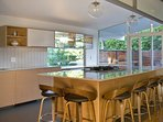 The massive island has seating for 6 to enjoy the elegant cooking space.