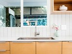 The spacious kitchen sink will make cleaning up a breeze.