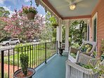 Relax on the front porch and gaze out at the lush neighborhood.