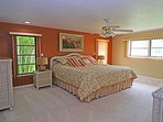 Master bedroom with king size bed, cable TV and access to lanai as well as water views