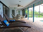 Covered lanai includes table and chairs for 4 plus 2 lounge chairs
