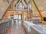This A-frame cabin features 2 bedrooms, 2 bathrooms, a loft, and room for 12.
