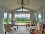 Wake up and enjoy your morning coffee in the master sunroom.