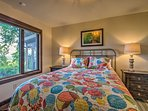 Sleep soundly in this room's queen bed.