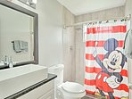 Kids will love taking baths in this Mickey Mouse-themed bathroom!