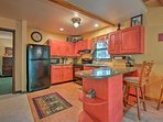 Crimson cabinets add the perfect pop of color to the fully equipped kitchen.