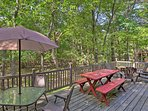 Wooded views surround both of the furnished decks.