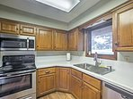 The kitchen has been updated with stainless steel appliances.