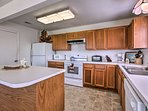 Prepare delicious dishes in the fully equipped kitchen.