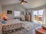 The master bedroom hosts 2 twin beds and direct access to a private balcony.