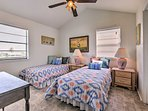 Two plush twin beds and a double closet furnish the second bedroom.
