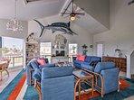 Beachy decor and a flat-screen Smart TV detail the open floor plan interior.