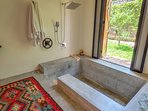 Master Suite Sunken Tub and Rain Shower which looks out onto the private side of the garden