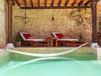 Loungers under the Cabana with Hammock over the pool