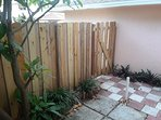 Private fenced patio for guest bedroom
