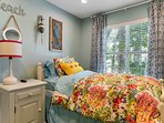 You'll love this colorful bedroom with a twin bed and twin trundle bed.