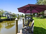 Sip sweet iced tea from the shade of the umbrella while you watch kayakers go by.