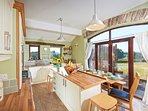 Kitchen can seat 10 people with great views across open fields towards the Langdales and Howgills