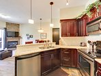Open concept kitchen with spacious granite counter tops