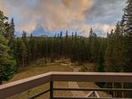 From the deck, gaze out over the grounds of the home to fire pit on the edge of the property.