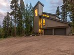 The warm glow of this home will be a welcome sight after a day of skiing.