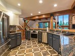 The kitchen has granite countertops and amazing views out the large windows in the living area.