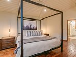 Chic lighting illuminates the traditional design in the Master Bedroom.