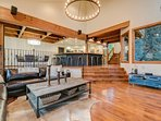 High ceilings in the living room give way to beautiful crisscrossed wood beams over the entryway and dining room.