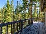 A spacious deck wraps around the exterior of this mountain home.