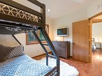 The bunk room also features a twin trundle bed and a TV.