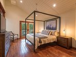 On the third floor, the Master Bedroom has a modern canopied king-size bed and a TV.