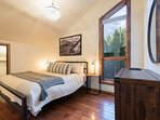 On the second floor, the second guest bedroom has a king-size bed.