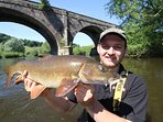 Happy customer of Angling Dreams, with a Barbel which this section of the Wye is famous for.