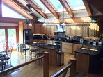 Beautiful open kitchen with cabinet's marked with kitchen items stored