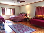 King size master bedroom with private entry to deck  & small 1/4 bath