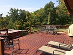 Large back deck with private area view of trees and bluff area