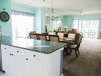 Open concept allows in plenty of light and keeps  family and friends together.