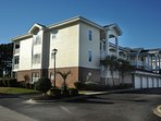 Second story, end unit in nice building in clean, nicely landscaped resort.
