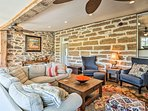 Pine floors, rock walls and exposed beams are original features.