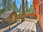 Tall pine trees surround this property.